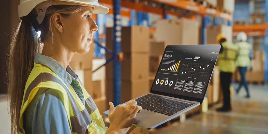 What is Transportation Management System ROI - Woman with Computer